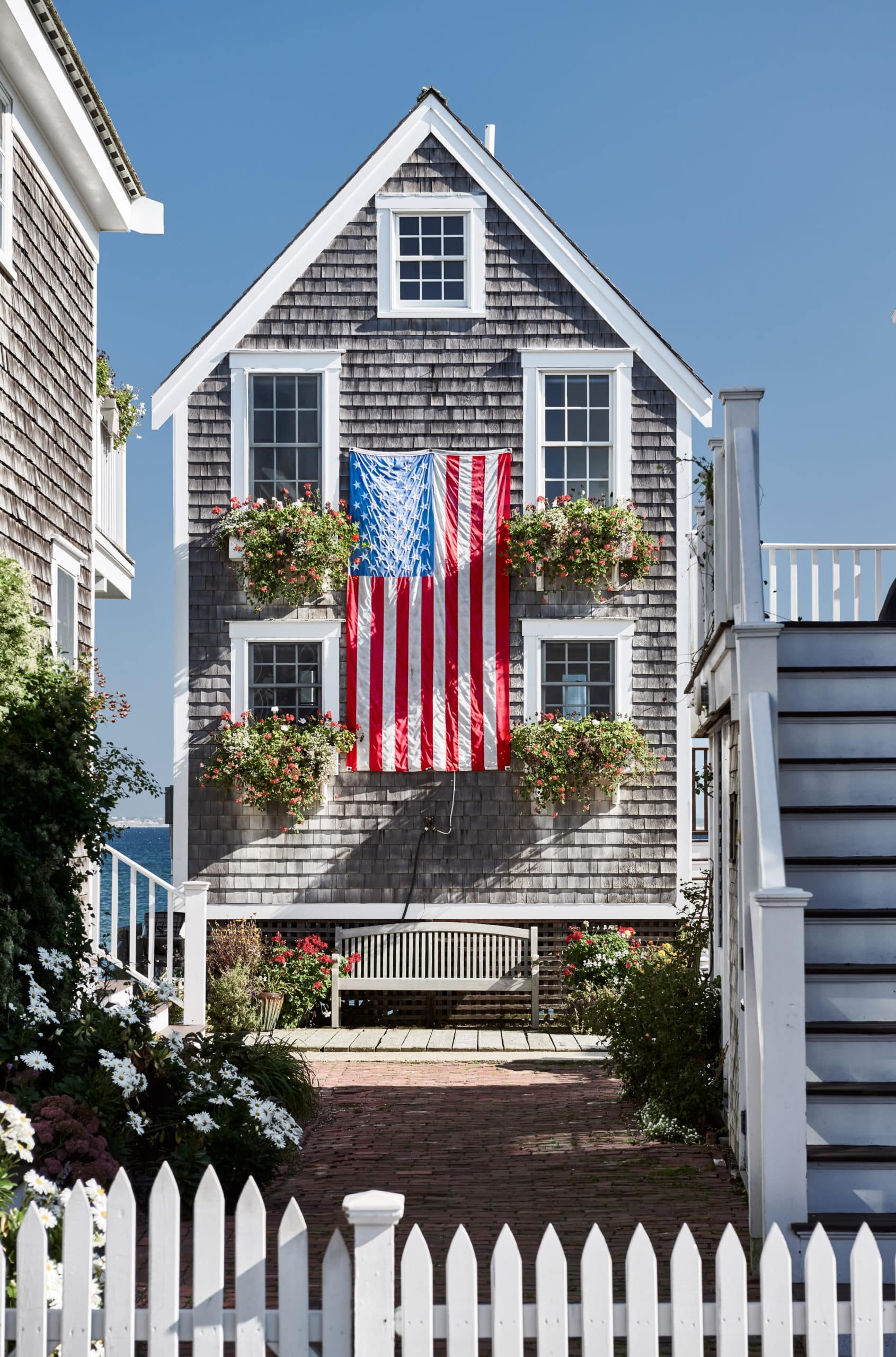 United States flag at suburban neighborhood. Provincetown, Cape Cod, Massachusetts, USA.