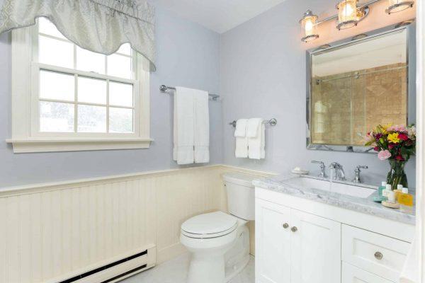 Room North Beach vanity, toilet, mirror and large window
