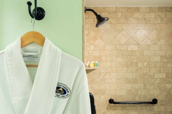 Old Harbor Inn bath robe and glass inclosed shower