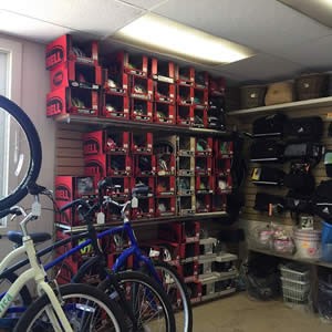 Bike shop with a variety of bike helmets and bicycles