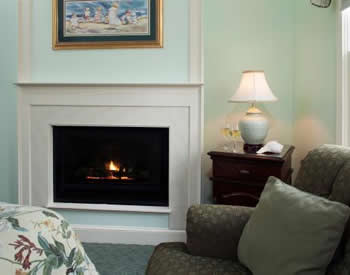 Light blue living area with upholstered furniture and a gas fireplace