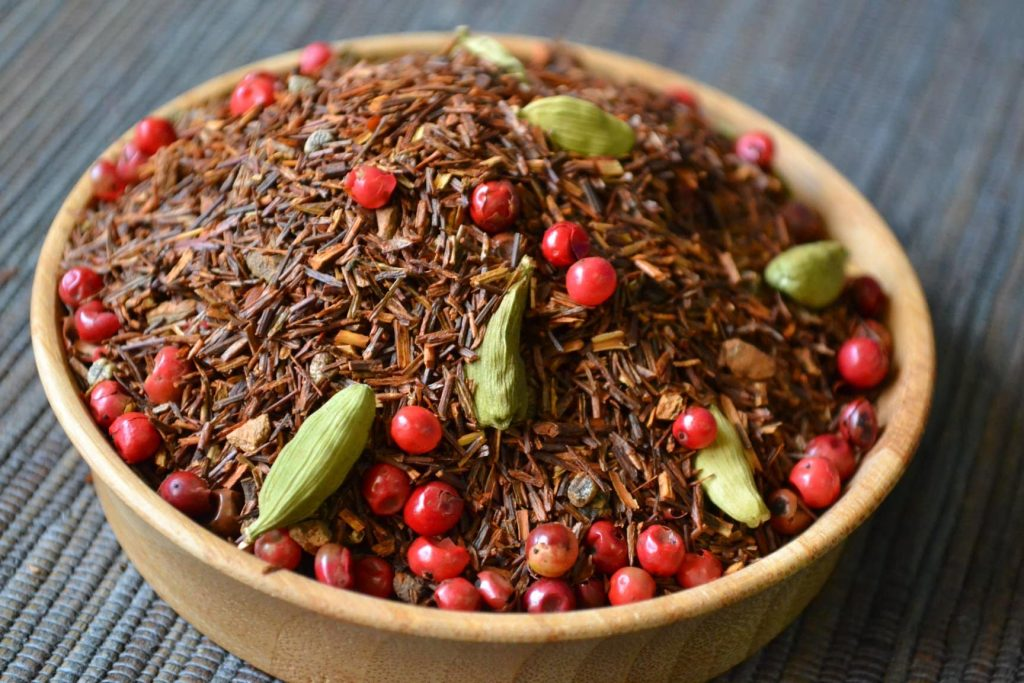 Loose tea in a ball with red berries
